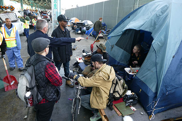 City Clears Homeless Encampment on Division Street
