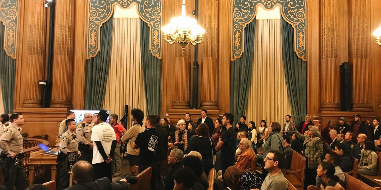 Dramatic scene unfolds as commissioner considers tie-breaking Taser vote