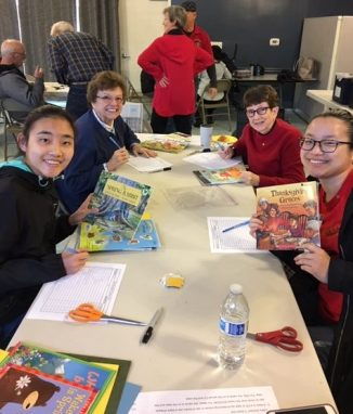Rotary members sending books to Uganda