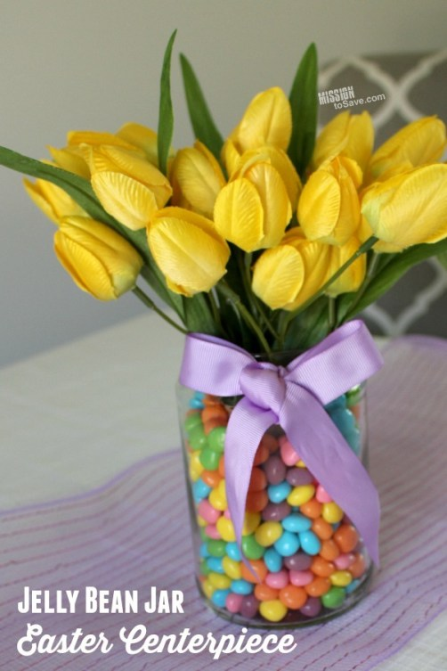 Tulip flowers in vase with jelly beans for easter table centerpiece