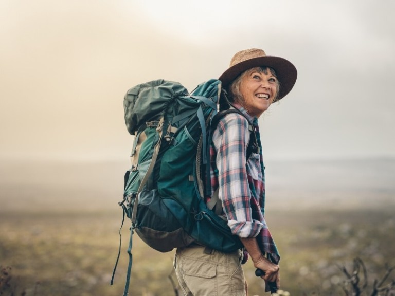 Woman hiking and traveling in retirement
