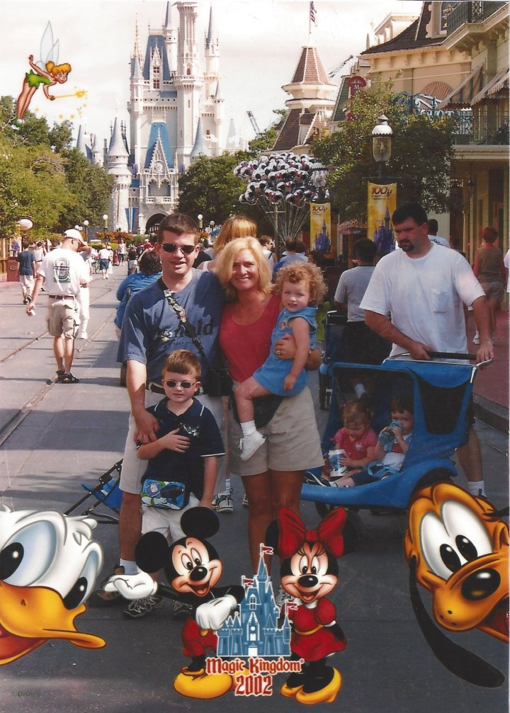 Craig, Traci, Ian, and Caylie in front of Cinderella's castle