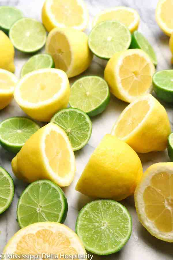 sliced lemons and limes on a marble board.