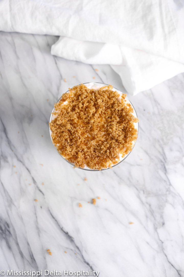 brown sugar on top of whipped cream in a glass