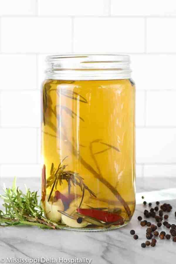 a jar of turkey brine on a marble board