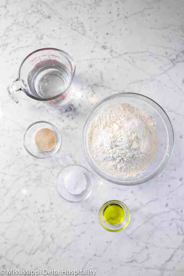 ingredients for pizza dough on a marble board