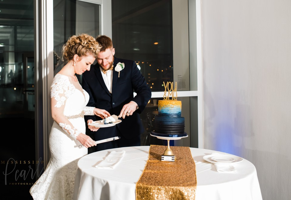 Groom and Bride cutting wedding cake