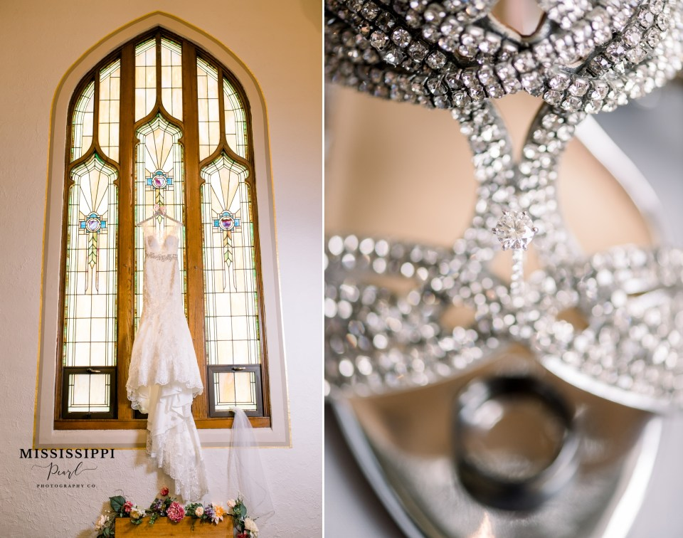 Allure Bridal dress from Savvy Chic hanging in church stained glass window and bridal shoes with engagement ring and wedding band.
