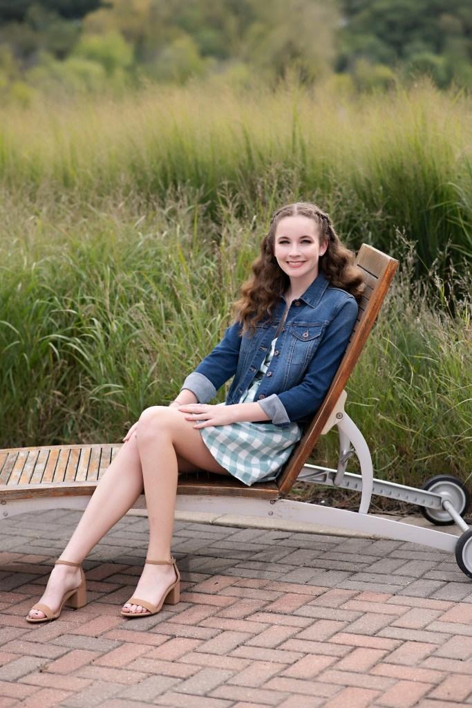 Cedar Rapids Iowa high school senior girl in long grass
