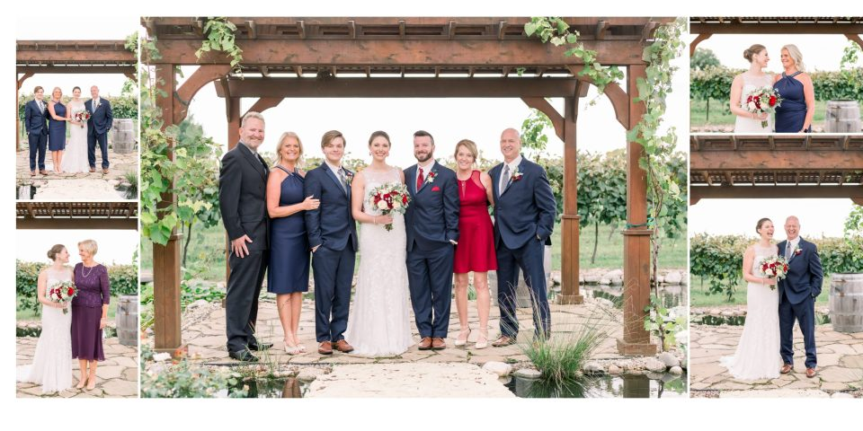 The couple and their families after their outdoor summer wedding in the vineyard.
