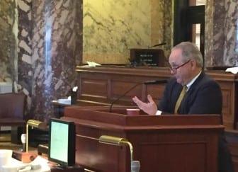 Sen. Buck Clarke, R-Hollandale, chairman of the Senate appropriations committee, discusses spending bills on the Senate floor Sunday.