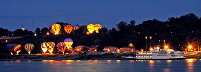 Pilots compete in The Great Mississippi River Balloon Race over Natchez and the Mississippi River.