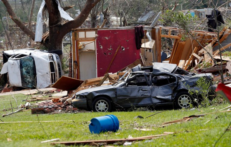 Destroyed automobiles and remnants of homes cover the ground in a south Louisville, Miss., neighborhood on April 29, 2014.