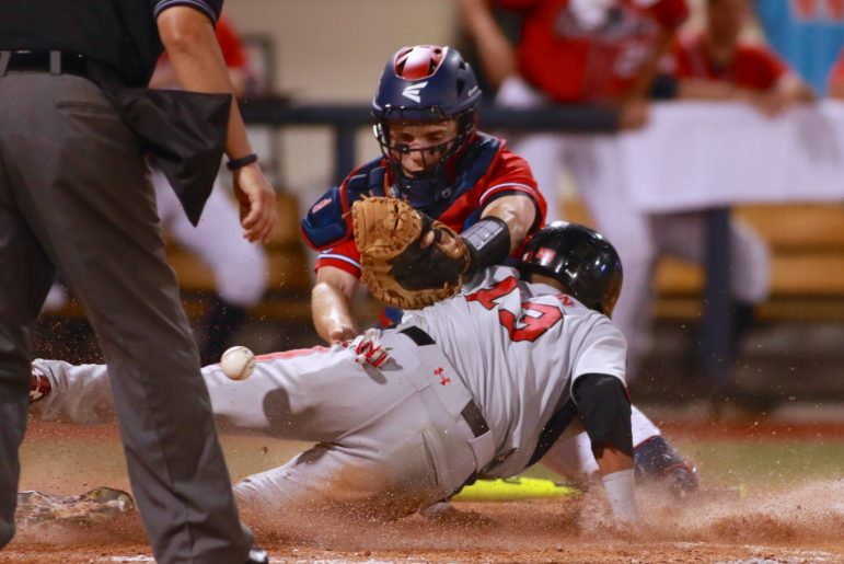 Andre jackson scores for Utah in the fifth inning on a sacrifice fly as Ole Miss catcher Henri Lartigue could not hold the ball.