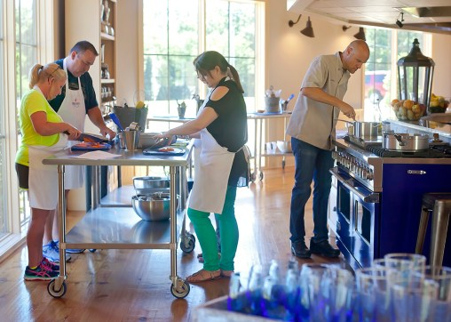 Executive Chef Matthew Sheeter, right, and his students work together to prepare a meal Tuesday, June 7, at the Farmer's Table Cooking School in Livingston.