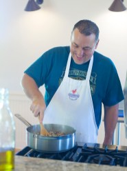 Barry Ypya is all smiles while preparing wild rice during a cooking course at Farmer's Table Cooking School in Livingston.