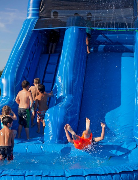 Water slides are a big hit with children at the Livingston Farmers Market.