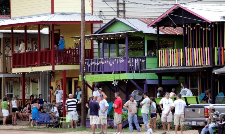 Fairgoers wait for another event outside their cabins at the Neshoba County Fair.