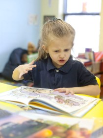 Preschooler Gabriella Reed becomes animated while reading a book at Charleston Elementary.