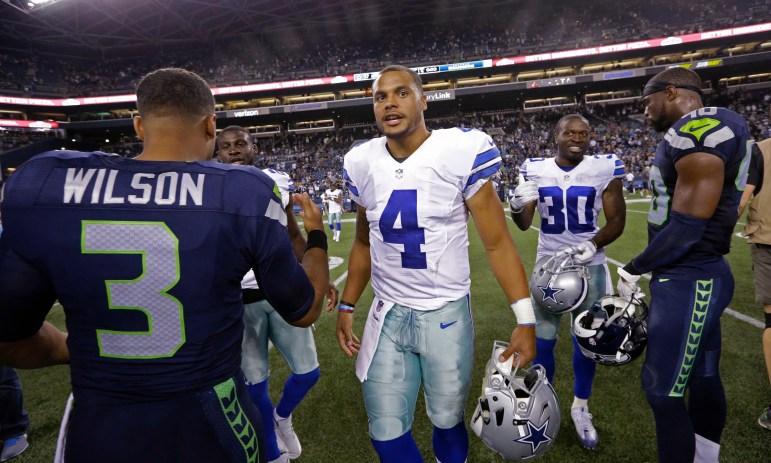 Dallas Cowboys quarterback Dak Prescott (4) talks with Seattle Seahawks quarterback Russell Wilson (3) after a preseason NFL football game Thursday in Seattle.