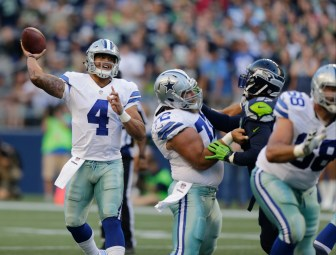 Dallas Cowboys quarterback Dak Prescott (4) passes against the Seattle Seahawks in the first half of a preseason NFL football game on Thursday.