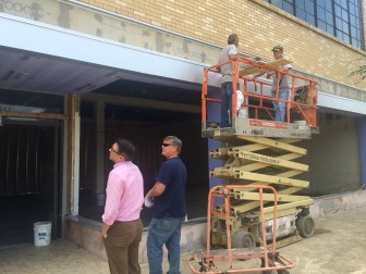 Will Coppage (left) of the Washington County Economic Alliance examines the exterior of the old Sears building, which is being turned into a boutique hotel.