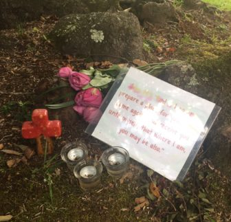 A makeshift memorial for Held and Merrill outside their home.