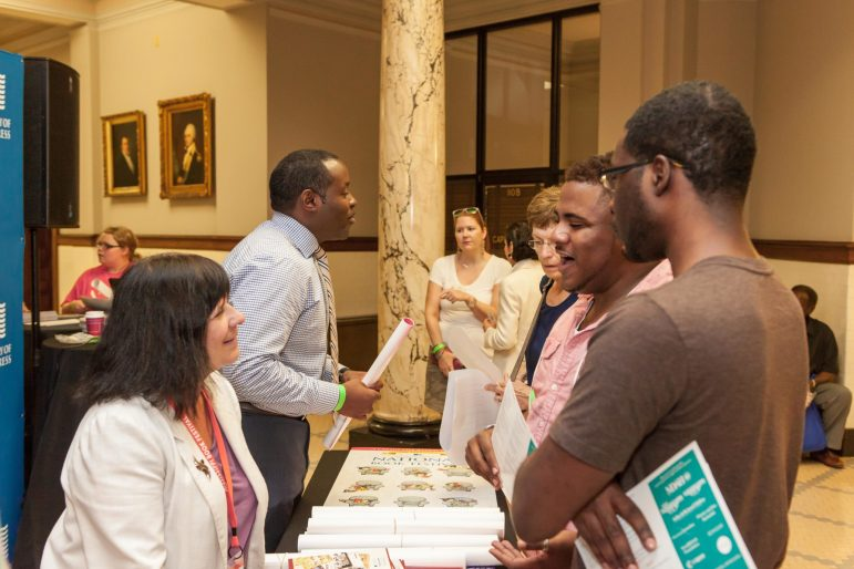 Patrons of the 2015 Mississippi Book Festival stop by the Library of Congress exhibit inside the Mississippi State Capitol.