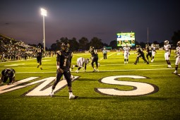 The East Side Trojans, in dark jerseys, defeated the Cleveland Wildcats 32-30. It was their first victory over their crosstown rivals in four years.