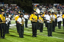 The Cleveland High School (in gold jackets) and East Side High School marching bands merged during the halftime show at Delta State University.