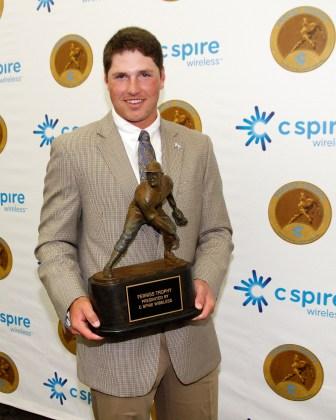 Hunter Renfroe holds the 2013 C Spire Ferriss Trophy.