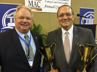 MSU President Mark Keenum (with Halbrook Trophies), flanked by Andy Halbrook of Ruston, La.