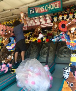 Fair worker restocks stuffed animal prizes at the Mississippi State Fair