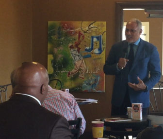 Mike Espy describes trade opportunities between Cuba and the United States at Koinonia Coffee House in Jackson.