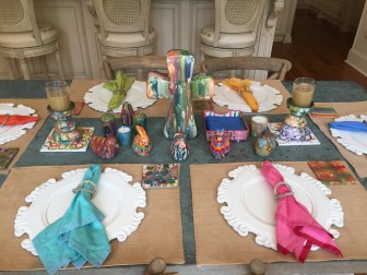 Rebecca Fountain's Memphis dining room table is set with her diverse collection of handmade Mustard Seed pottery.
