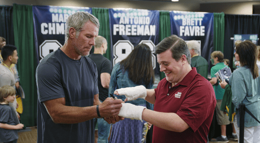 Brett Favre signs Chris Marroy's casts to end TV commercial