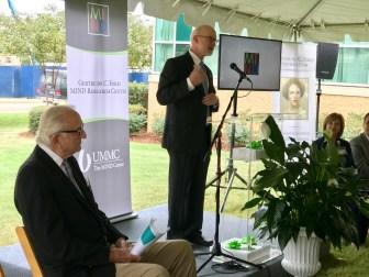 Dr. Tom Mosley, director of the MIND Center at UMMC, speaks at the dedication as Ambassador John Palmer looks on.