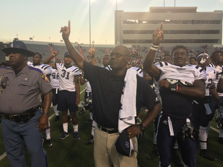 Tony Hughes and his JSU players during traditional post-game alma mater.