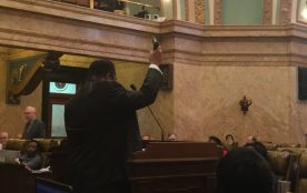 Rep. Charles Young, D-Meridian, presents an unloaded gun to oppose a bill that would allow concealed carry permit holders to sue agencies that limit the ability to concealed carry weapons.