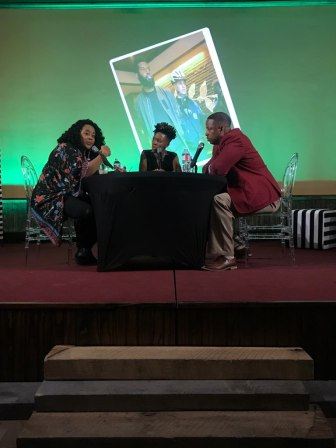 Maranda Joiner, Rita Brent and Roderick Richardson sitting at a table on stage.