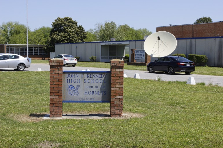 A sign outside of John F. Kennedy High School in Mound Bayou depicting its name