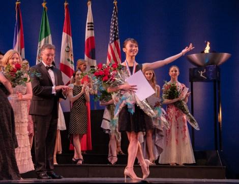 USA dancer Chisako Oga is awarded the women's senior bronze medal.