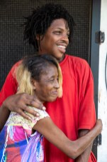 Mary Hardege hugs her son, J.D. Benfield, at their home on Leonard Street in Jackson's Farish Street Historic District Thursday, July 5, 2018. The family has lived in the historic district for nearly 20 years.