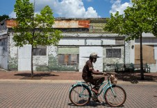 A man rides his bicycle in the 300 block of Farish Street in Jackson Wednesday, June 27, 2018. Farish Street Historic District, once the heart and soul of black Mississippi's civic cultural life, is still home to a dynamic neighborhood that is fighting to hold the community together.
