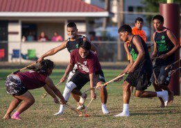 Teenagers compete during the World Series of Stickball at the Choctaw Indian Fair in Choctaw Wednesday, July 11, 2018.