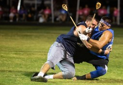 A player is tackled during the World Series of Stickball during the Choctaw Indian Fair at Choctaw Central High School Wednesday, July 11, 2018.
