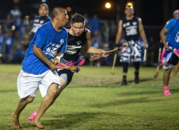 Adult players attempt to score a goal during the World Series of Stickball at the Choctaw Indian Fair in Choctaw Wednesday, July 11, 2018.