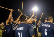 Pearl River community celebrate their victory against Koni Hata during the World Series of Stickball at the Choctaw Indian Fair in Choctaw Wednesday, July 11, 2018.