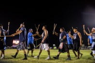 Pearl River community and Koni Hata community teams congratulate each other during the World Series of Stickball at the Choctaw Indian Fair in Choctaw Wednesday, July 11, 2018.