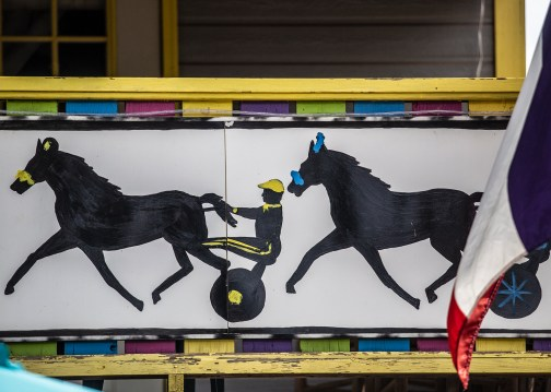 A painting depicting competing harness racers is seen on the front of a cabin at the the Neshoba County Fair in Philadelphia, Miss. Wednesday, August 1, 2018.